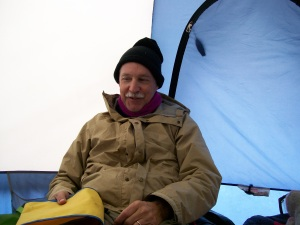 Author in tent, 2007, Lake Insula trip where we evaluated all 47 campsites. Snow and cold weather made the job interesting.
